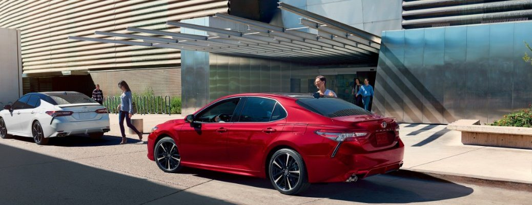 2020 Toyota Camry parked in front of a modern hotel