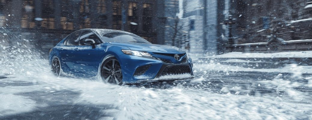 2020 Toyota Camry driving through snow downtown