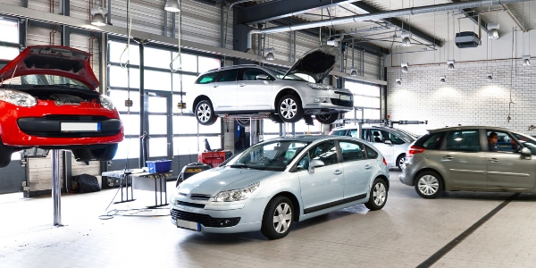 Vehicles in automotive shop