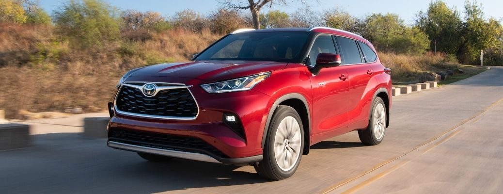 Red 2020 Toyota Highlander Hybrid from exterior front driver's side