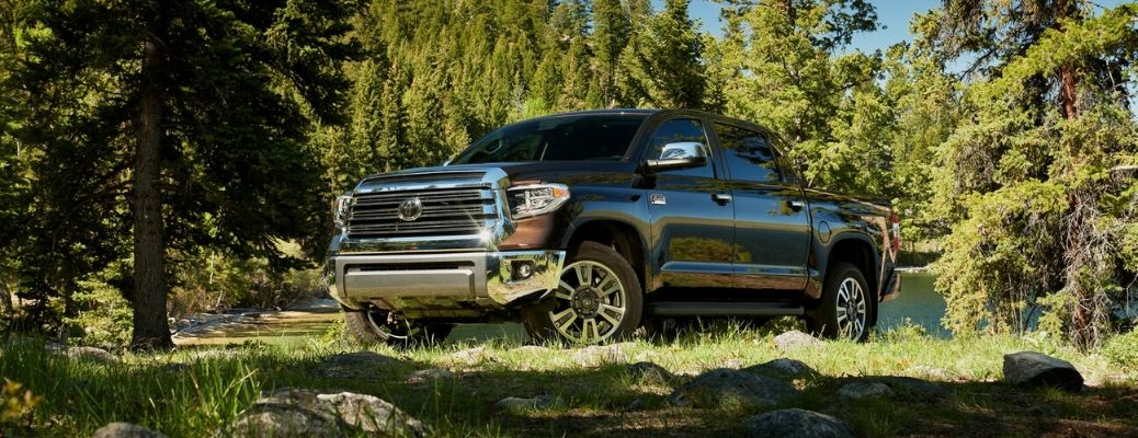 2020 Toyota Tundra parked in front of trees and a lake