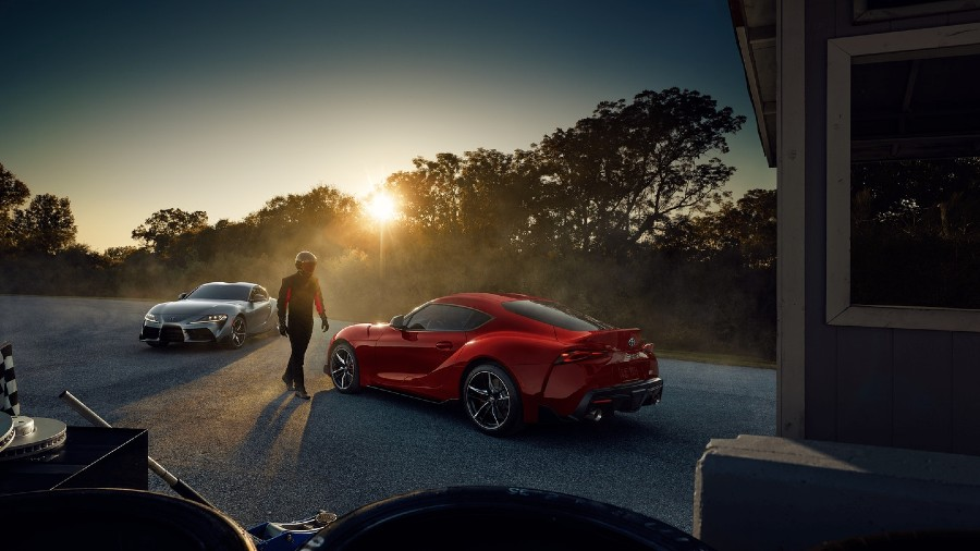 Two 2020 Toyota Supra models with driver