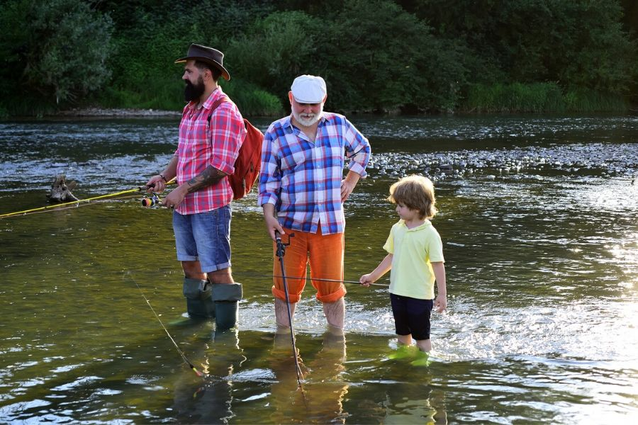 Grandpa, son and grandson fishing together