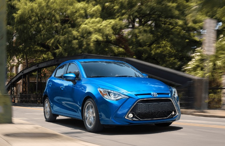 2020 Toyota Yaris Hatchback driving on a road