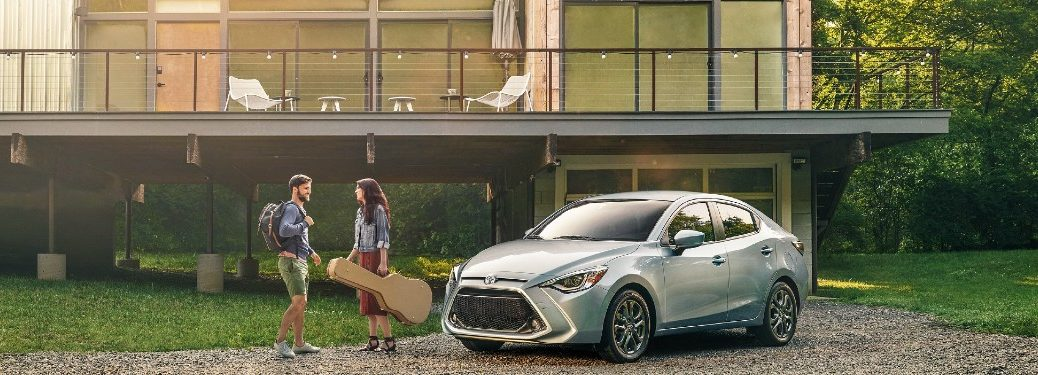 2020 Toyota Yaris Sedan parked in front of a house