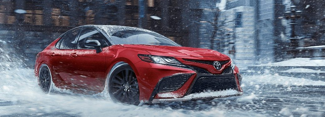 2021 Toyota Camry driving on a wet road