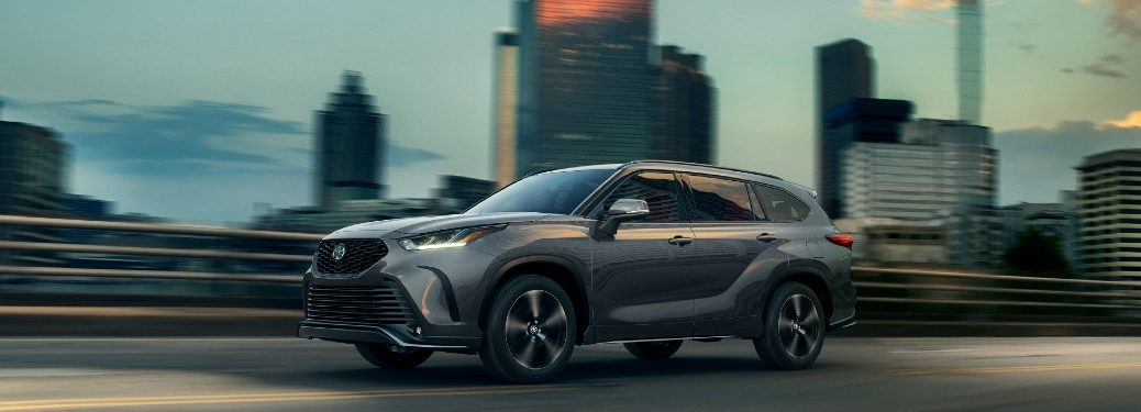 2021 Toyota Highlander driving on a road