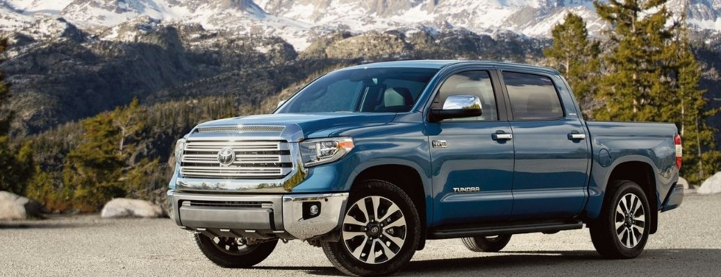 side view of the 2021 Toyota Tundra with mountains in the background