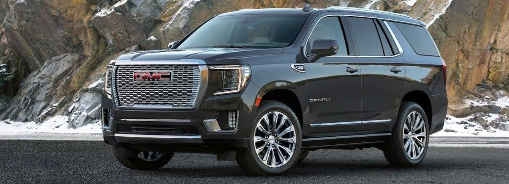 2021 GMC Yukon parked in front of a snowy mountain