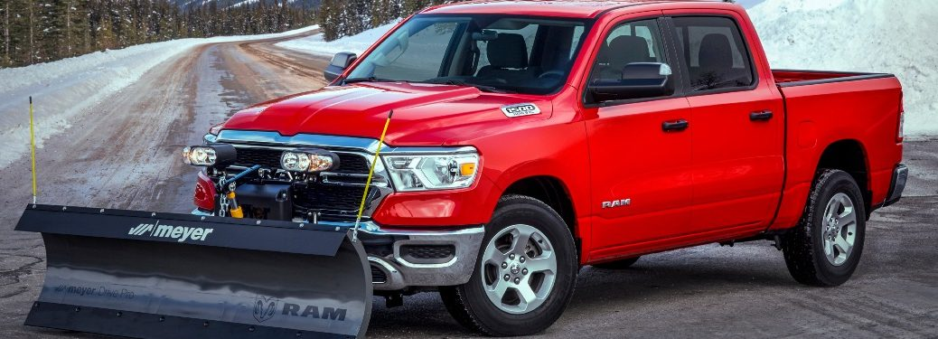 2021 RAM 1500 Snowplow Package and Snowy Mountain behind the truck