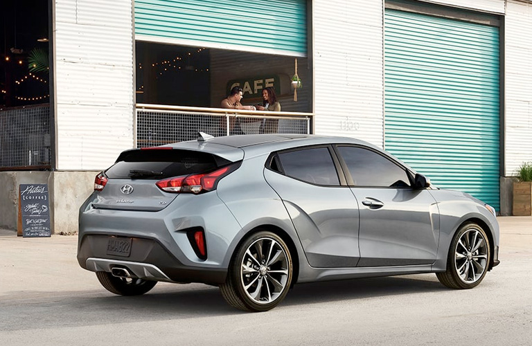 2020 Hyundai Veloster parked in front of a garage