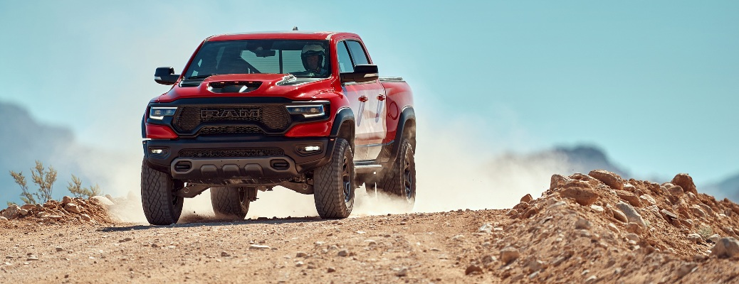 2021 RAM 1500 TRX flying over a dirt hill