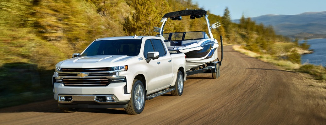 2021 Chevrolet Silverado 1500 puling a boat down the road