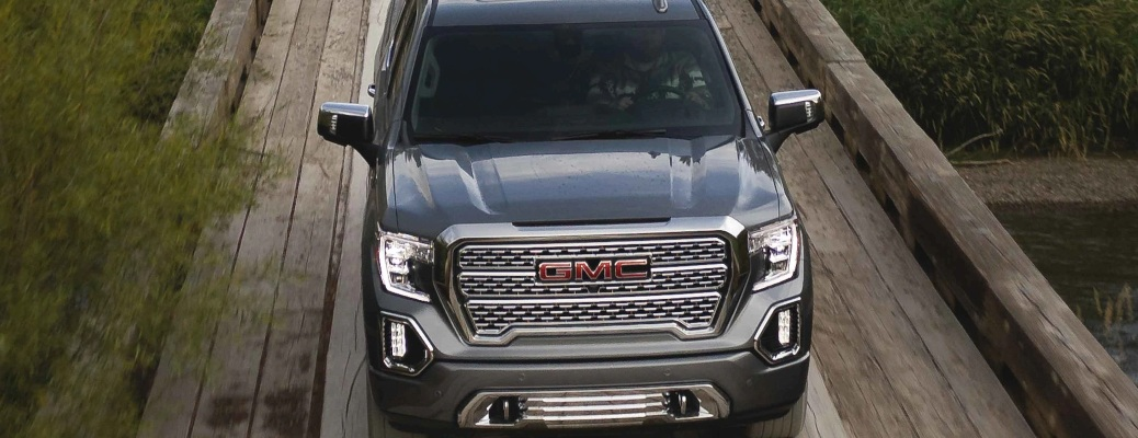 2021 GMC Sierra 1500 Denali going down a wooden road