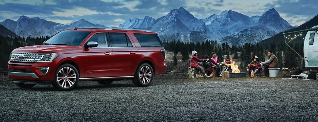 2021 Ford Expedition next to family having a camp fire