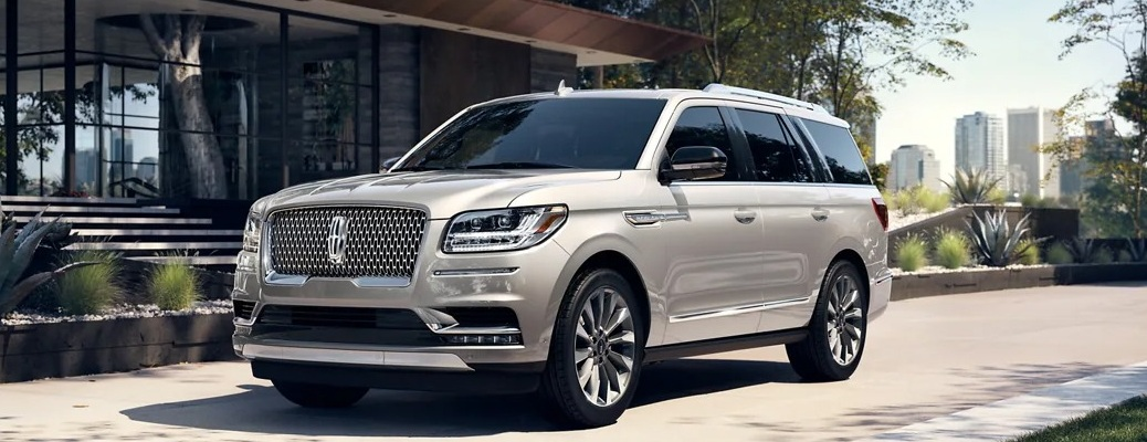 2021 Lincoln Navigator with big city in the background