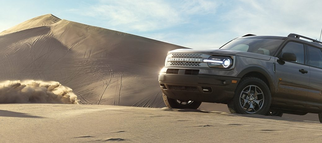 The 2021 Ford Bronco Sport in action on top of a sand dune