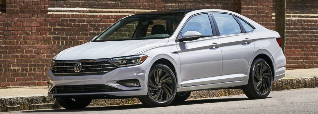 White 2019 VW Jetta Parked by a Brick Building