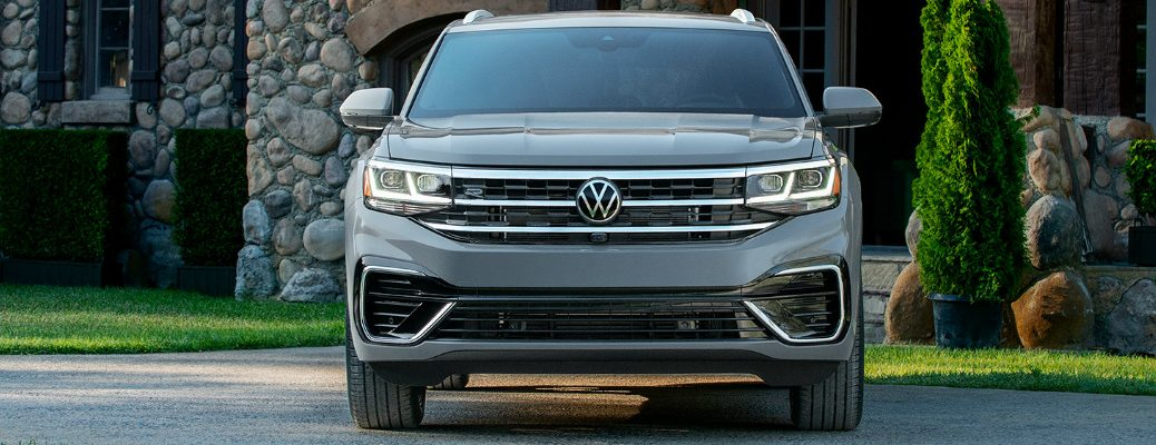 Grey 2020 Volkswagen Atlas Cross Sport parked in front of a stone house