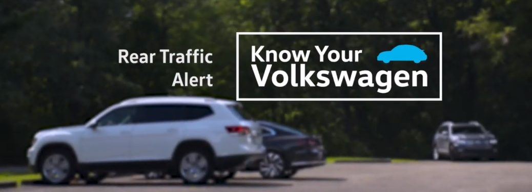 Rear Traffic Alert Know Your Volkswagen title and Volkswagen vehicles in a parking lot