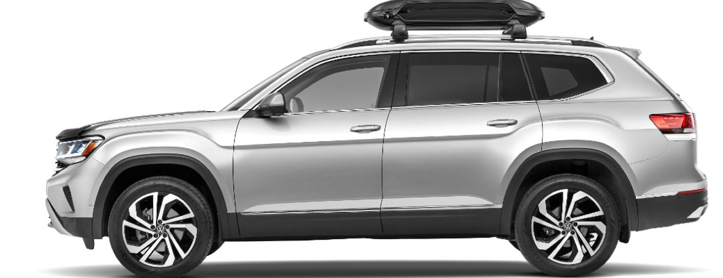 Side view of silver Volkswagen Atlas with a rooftop cargo box