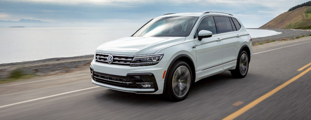 White 2020 Volkswagen Tiguan driving on a coastal road
