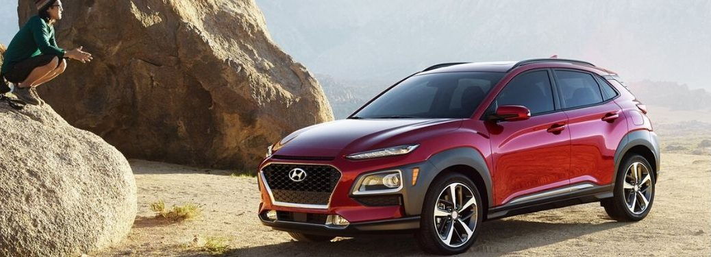 2020 Hyundai Kona exterior front fascia driver side on cliff with person on rock