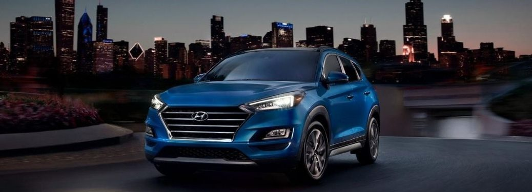 2021 Hyundai Tucson exterior front fascia driver side in front of city at night A image