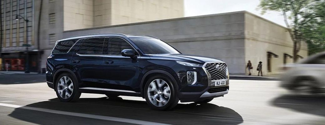 2022 Hyundai Palisade shown in blue moving on the road