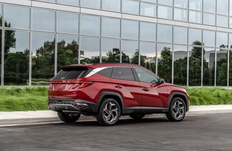 2022 Hyundai Tucson exterior rear fascia passenger side in front of glass building