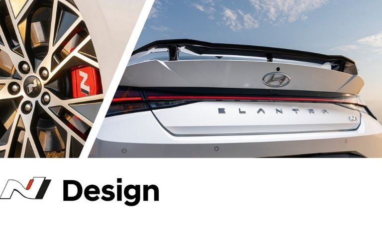 The rear wing spoiler of the 2022 Hyundai Elantra next to the N Design alloy wheels