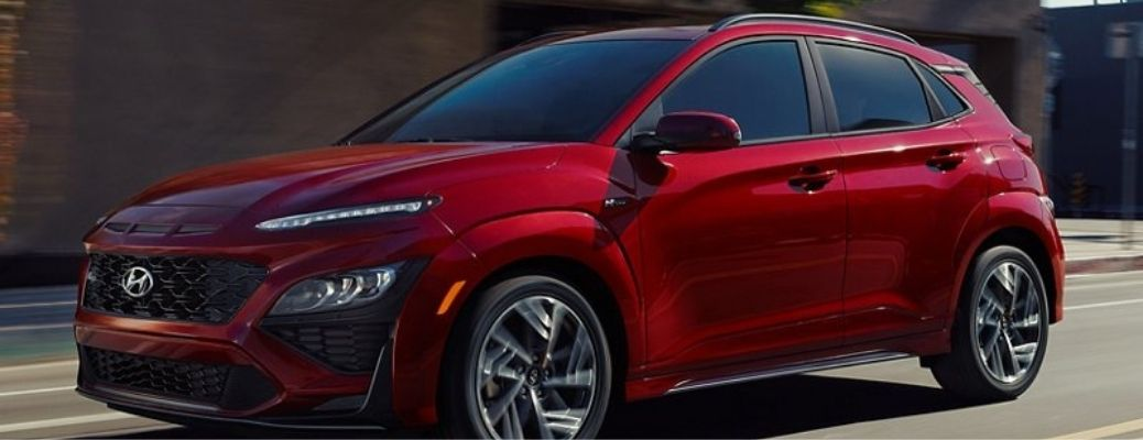 2022 Hyundai Kona Pulse Red with black roof moving on the road