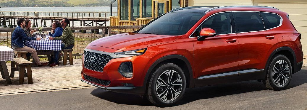 Front driver angle of an orange 2020 Hyundai Santa Fe