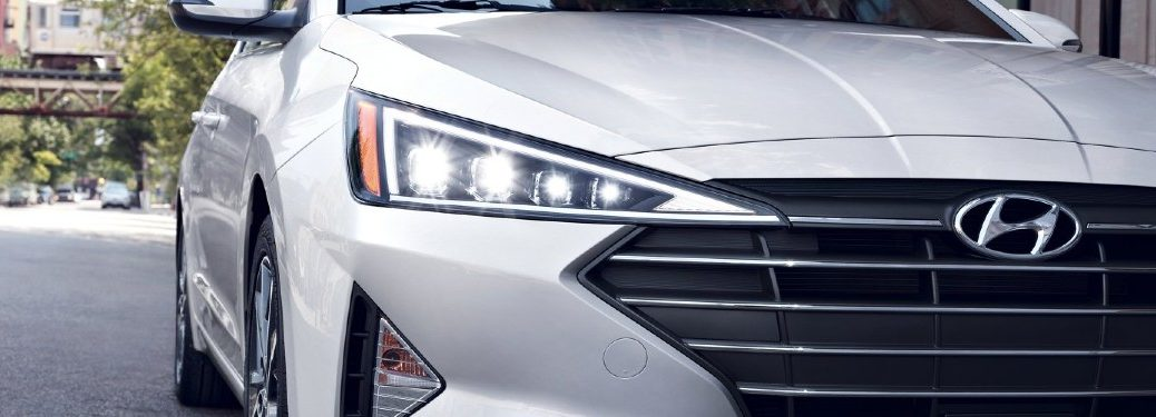 Close up of the Hyundai logo on a white 2020 Hyundai Elantra