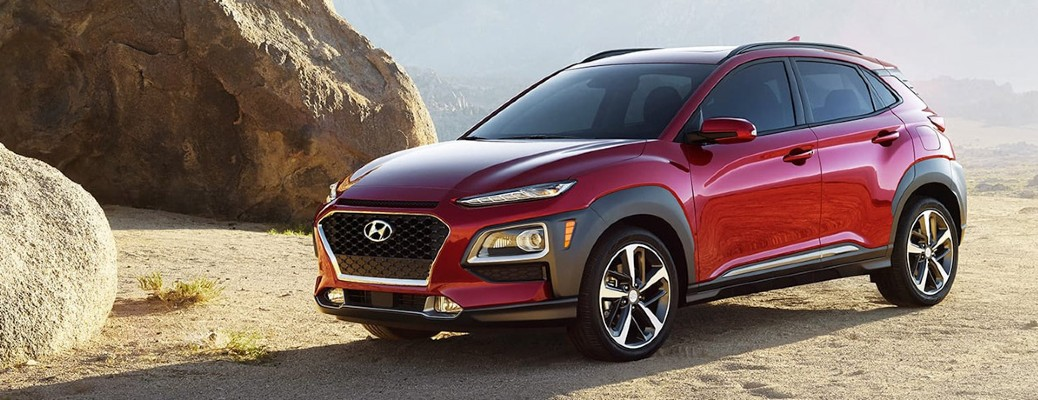 A dark red 2020 Hyundai Kona parked on top of a rocky hill.