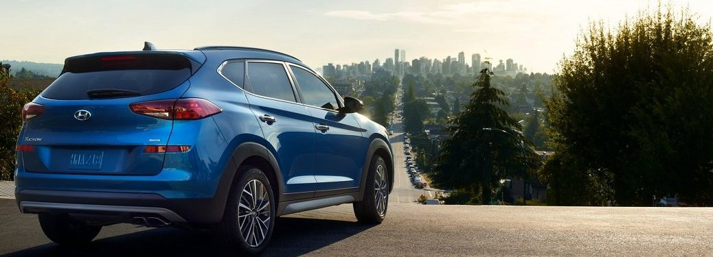 2021 Hyundai Tucson parked in front of a large forest