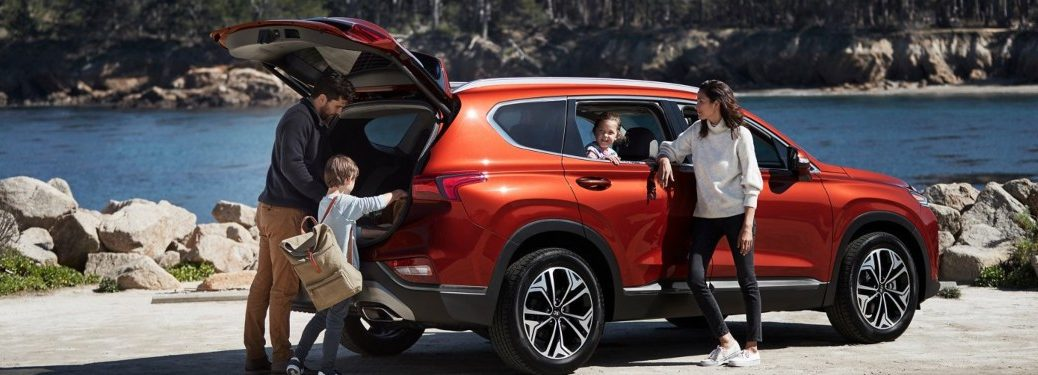 A family getting cargo out of a 2021 Hyundai Santa Fe