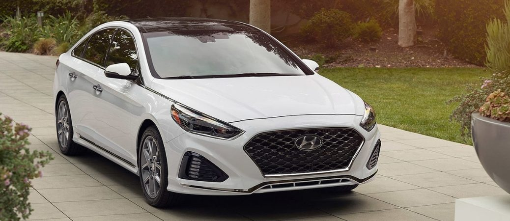 White 2019 Hyundai Sonata parked in residential driveway