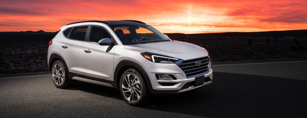 Side view of 2020 Hyundai Tucson with sunset background