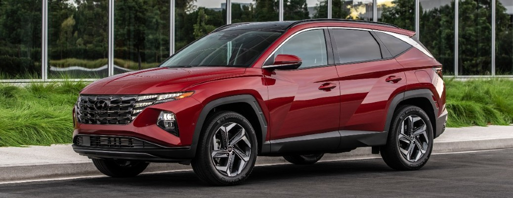 The side view of a red 2022 Hyundai Tucson.
