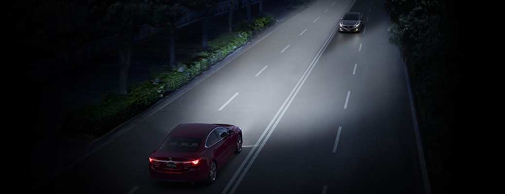 i-ACTIVSENSE safety technologies two cars driving at night AFS and HBC