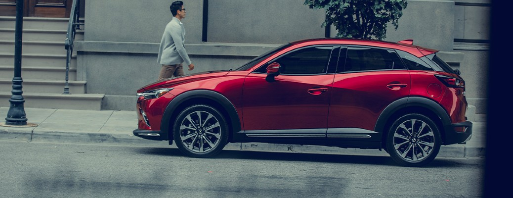 2020 Mazda CX-3 red exterior driver side parked on side on road in city