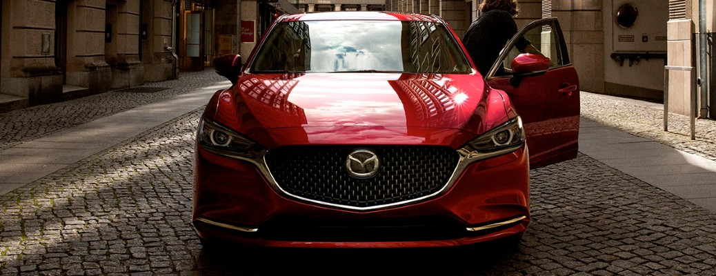 2020 Mazda6 red exterior front parked in middle of street woman getting out of drivers seat