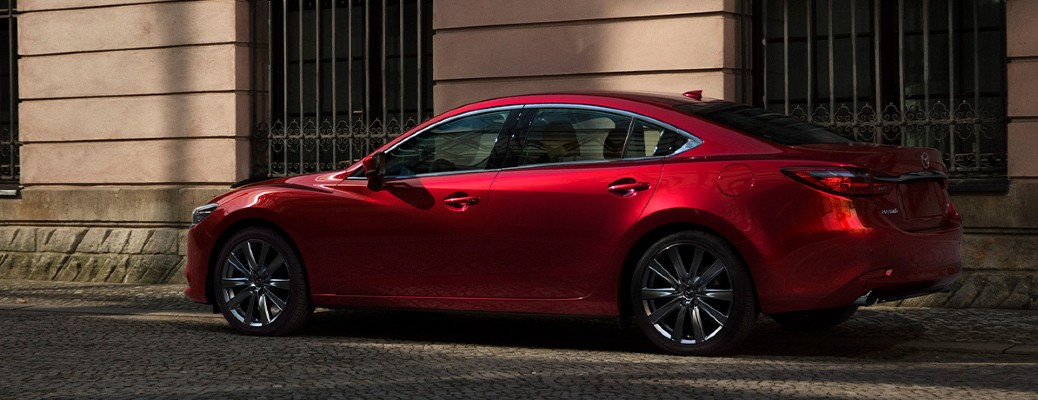 2021 Mazda6 red exterior driver side parked on side of road
