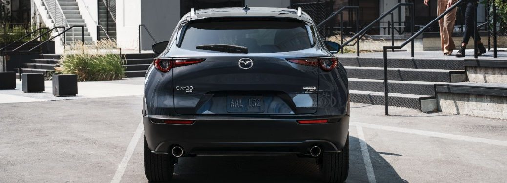 grey 2021 Mazda CX-30 rear fascia parked in parking spot couple walking down stairs