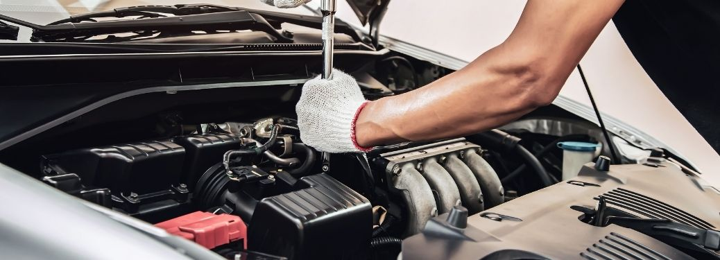 Mazda Protection Products Technician servicing a car