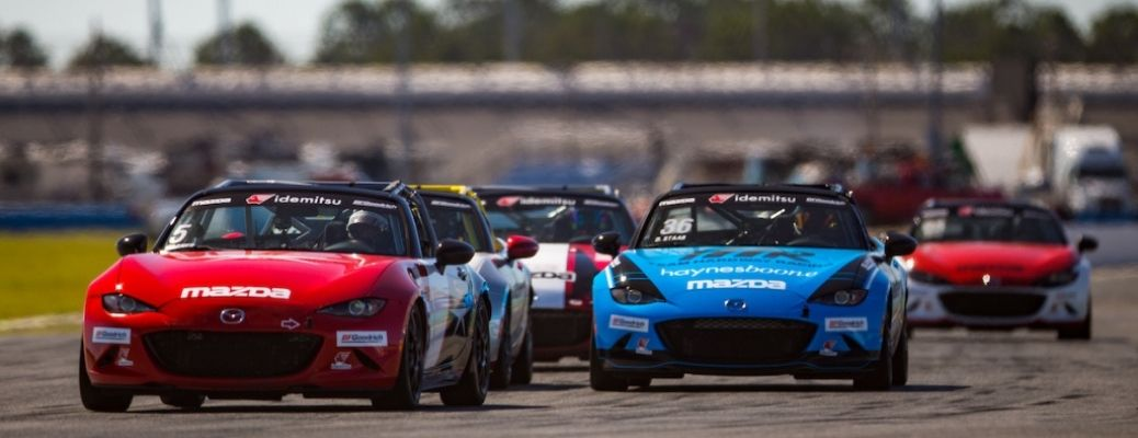 Mazda MX-5 Cup Cars Racing on a racetrack