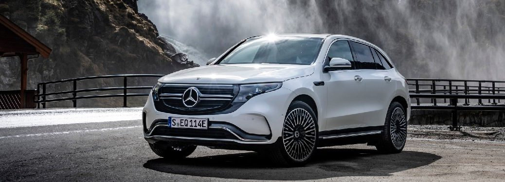 2020 Mercedes-Benz EQC parked in front of waterfall