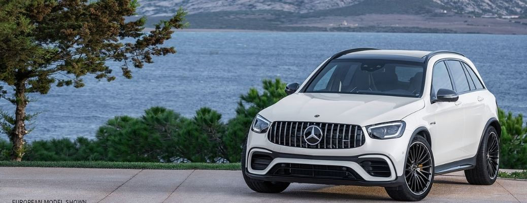 2022 Mercedes-AMG GLC 63 S SUV parked beside a lake
