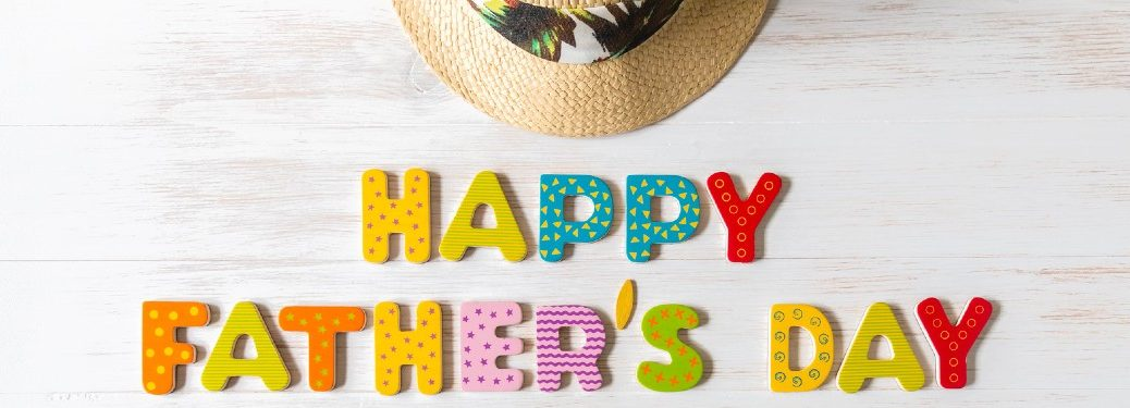 "Colorful letters showing ""Happy Father's Day"" on a white background"